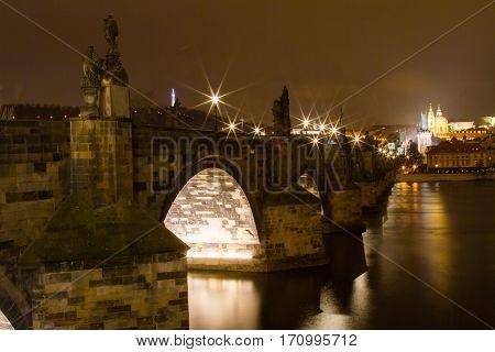 The ancient Charles bridge in Prague across the river Vltava (Czech Republic). February 2016