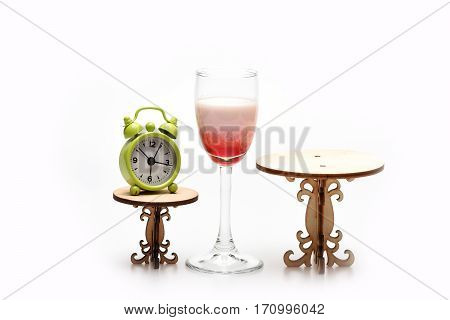 Alcohol Coctail Singapore Sling With Clock On Decorative Table