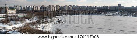 MOSCOW RUSSIA - FEBRUARY 2017: Borisovskie Prudy - Borisovskie ponds Borisovo district Trinity Church Orekhovo district park and walking people panorama photo.