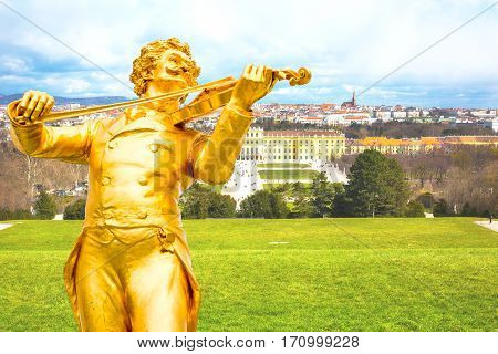 Johann Strauss statue, Schonbrunn view and Vienna panoramic skyline background, Austria