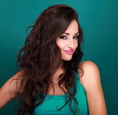 Coquette grimacing emotional makeup woman with long curly hair style looking on light green background poster