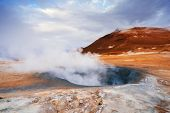 Landscape with eruption steam. Geothermal area Namafjall, Iceland, Europe. Overcast day poster
