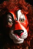 scary Halloween like monster lion mask with real eyes lurking in the dark and haunting with fear poster