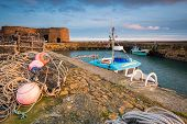 Beadnell Harbour Fishing Gear, at Beadnell village on the Northumberland coastline, which is a small fishing harbour set into Beadnell Bay. Disused medieval Lime Kilns sit in the harbour poster
