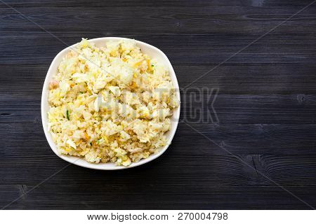 Chinese Cuisine Dish - Top View Of Bowl With Fried Rice With Shrimps, Vegetables And Eggs (yangzhou
