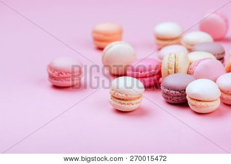 Different Types Of Macaroons On Pink Background. Sweet And Colourful French Macaroons.