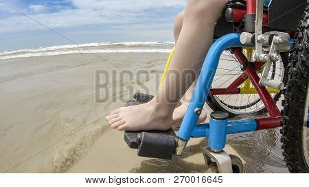 childlike wheelchair horizon sand foot child interation poster