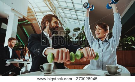 Corporate Sport Lifestyle. Healthcare Of Business People. Office Workers Working With Dumbbells. Wor