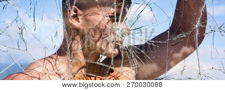His Ambition Knows No Bounds. Strong Man Seen Through Cracked Glass. Sport Man With Muscular Strengt