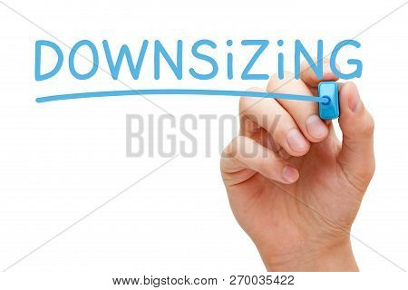 Hand Writing The Word Downsizing With Blue Marker On Transparent Glass Board Isolated On White.