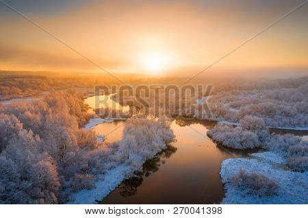 Sunny Winter Morning. Beautiful Winter Landscape With River And Fog. White Trees Covered With Frost