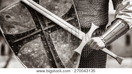 Closeup View On Traditional Medieval Knight With Shield And Sword. Image In Black And White Color St