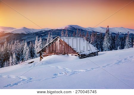 Picturesque view of the countryside. Frosty morning in the farm land. Location Carpathian mountains, Ukraine, Europe. Beautiful nature landscape. Perfect winter wallpaper. Explore the beauty of earth.