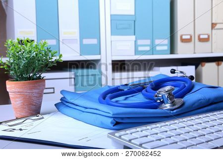 A Medical Stethoscope And Rx Prescription Are Lying On A Medical Uniform