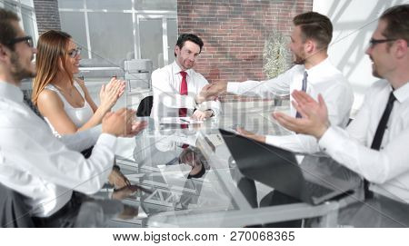 business team applauds business partners at the meeting
