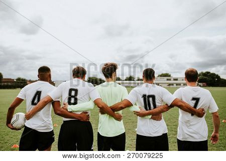 Football players standing together side by side
