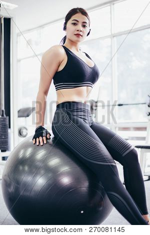 Asian Women  Beautiful, Sports Girl Does Exercises On A Fitball At The Gym,soft Focus