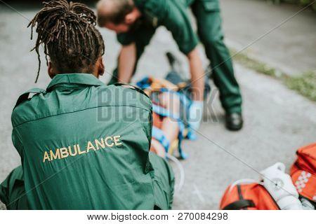 Paramedic team rescuing an injured patient