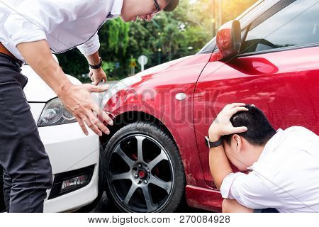 Two Men Arguing After A Car Accident Traffic Collision On The Road