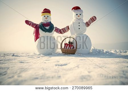 Xmas Or Christmas Decoration. Happy Holiday And Celebration. New Year Snowman From Snow In Hat. Chri