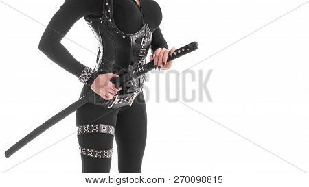 cropped image of a woman in black cosplay costume removing katana sword from the sheath. Isolated on white poster