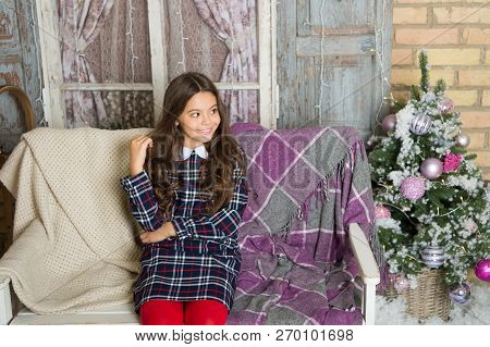 Make A Wish. Small Cute Girl Dreaming About Christmas Gift. Kid Dreamy Sit Sofa Dreaming About Chris