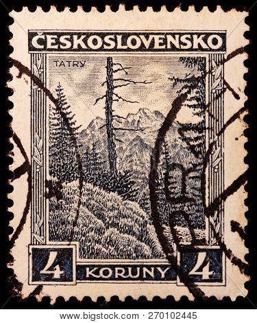 Luga, Russia - January 23, 2018: A Stamp Printed By Czechoslovakia Shows Beautiful View Of Tatra Mou