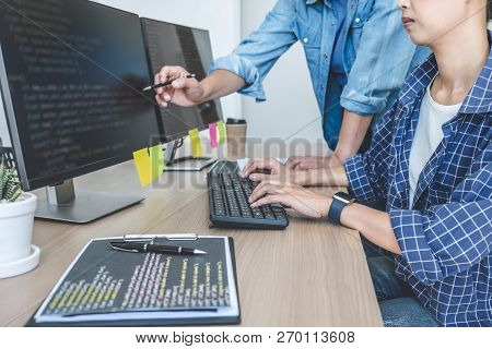 Writing Codes And Typing Data Code Technology, Two Professional Programmer Cooperating Working On We