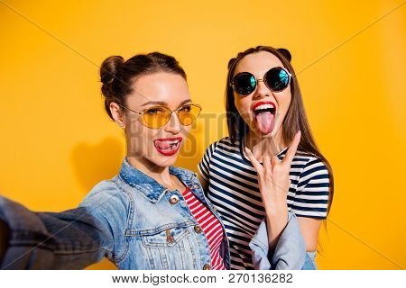 Carefree Careless Funny Glad Two Girlish Lady Isolated On Yellow Shine Background In Trendy Glasses