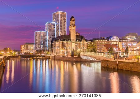 Evening Cityscape Of Malmo, Sweden. Modern And Old Historical Buildings Reflected In The Water. Pict