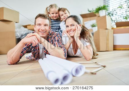 Happy family and children after moving to new apartment or home