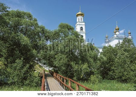 Wooden Bridge Leading To The Church Of The Transfiguration On The Sunny Summer Day, Shuya Town, Ivan