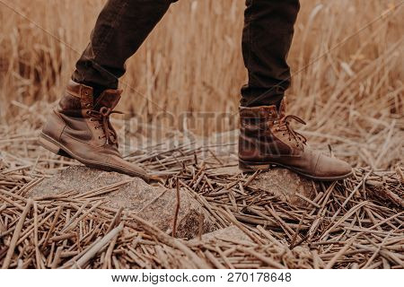 Mens Brown Shoes In Rural Territory. Unrecognizable Masculine In Trouses And Boots. Leather Old Foot
