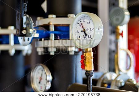 Closeup Of Manometer, Measuring Gas Pressure. Pipes And Valves At Industrial Plant. Pressure Gauge,