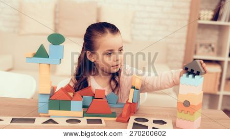 Little Girl Playing With Cubes. Educational Games. Learning Child At Home. Build House Of Cubes. Chi