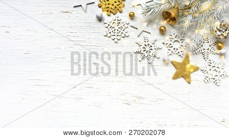 Christmas White Fir Tree Branches Pine Cone Old Gold Jingle Bell And White Decorations On White Wood