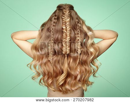 Blonde Girl With Long And Shiny Curly Hair. Beautiful Model Woman With Curly Hairstyle. Care And Bea
