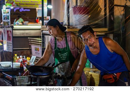 Bangkok, Thailand - November 2018: Thai Muslim Couple Are Preparing And Cooking Thai Food In The Eve