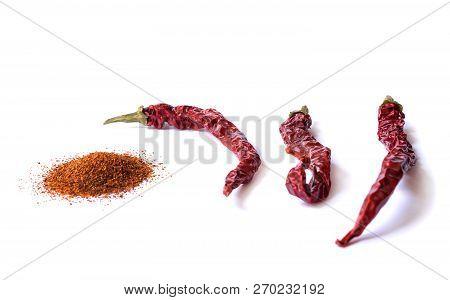 Dried Red Chili Pepper Isolated On White Background. Desiccated Milled Paprika. Stock Images.