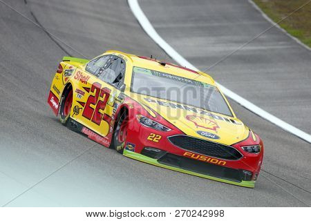 November 16, 2018 - Homestead, Florida, USA: Joey Logano (22)  races through turn one to practice for the Ford 400 at Homestead-Miami Speedway in Homestead, Florida.