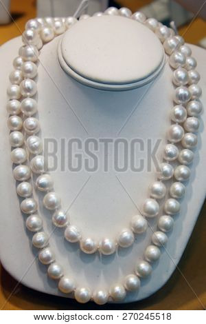 Pearl Necklace. Pearl Necklace on a manikin bust.  poster