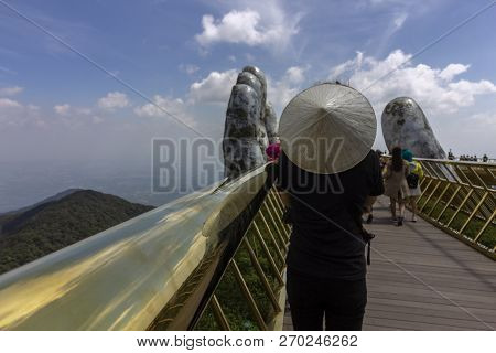 Da Nang, Vietnam - October 31, 2018: Tourists In Golden Bridge Known As