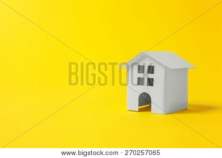 Simply Design With Miniature White Toy House Isolated On Yellow Colourful Trendy Modern Fashion Back