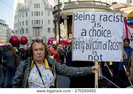 London, United Kingdom, November 17th 2018:- Anti Racist Proteser At The Stand Up To Racism March Th