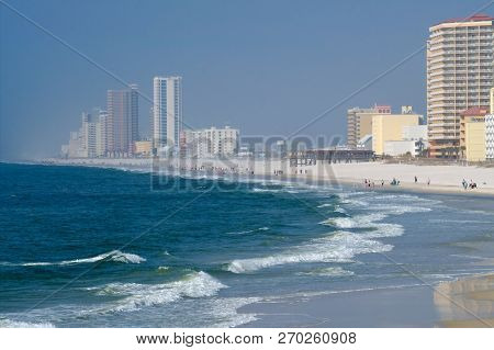 Condos and hotels on the shore of the Gulf of Mexico at Orange Beach, Alabama on a hazy day. poster