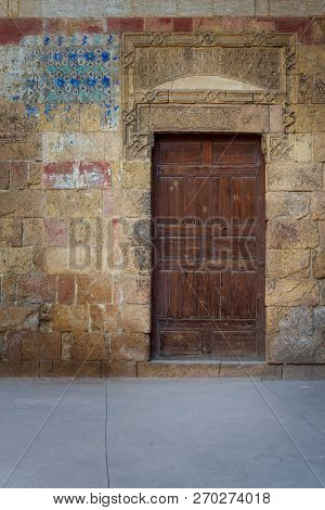 Old Wooden Door Framed By Bricks Stone Wall, Old Cairo, Egypt