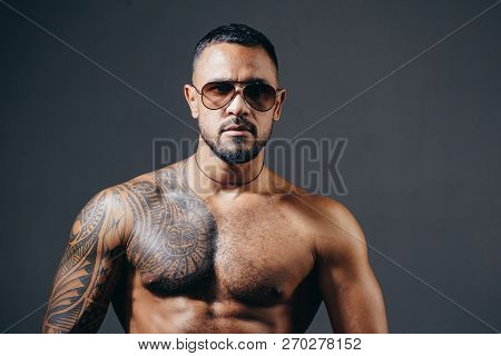 Sungalass Male Portrait. Mans Fashions Sungalass. Handsome Man Closeup Portrait. Stylish Latin Man.