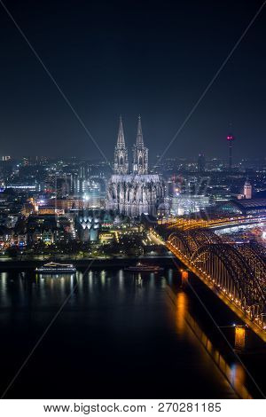 View Of The Illuminated City Of Cologne, The Cologne Cathedral, The Hohenzollernbridge And The River