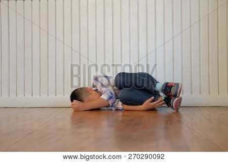 Depressed Upset Sad Asian Kid Boy Child Children Lying On Floor Suffering Abuse Problem