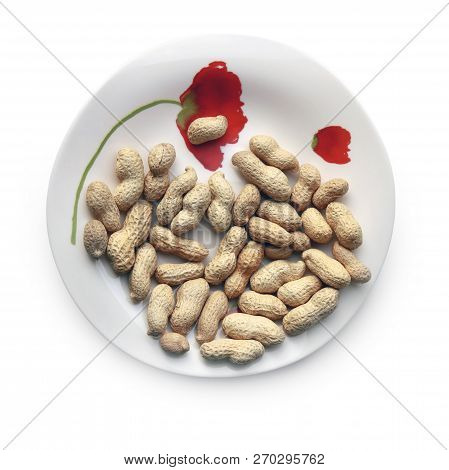 Roasted Peanuts In Their Nutshells On The Beautiful Plate Against White Background. Selective And So